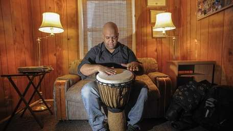 Mike Veny, 33, of Astoria plays his drum