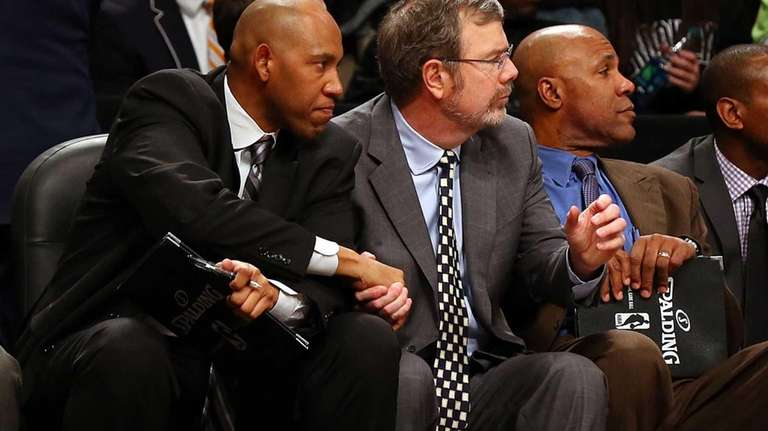 Assistant coach Popeye Jones of the Nets congratulates