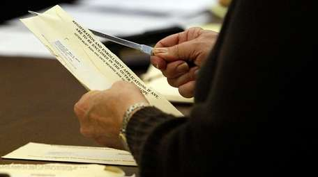 Poll workers at the Yaphank Board of Elections