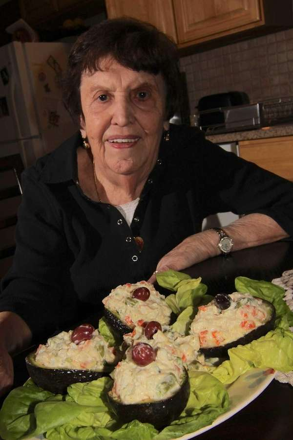 Paulette Esposito shows off her dish of avocado