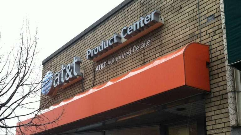 Two men armed with handguns robbed an AT&T