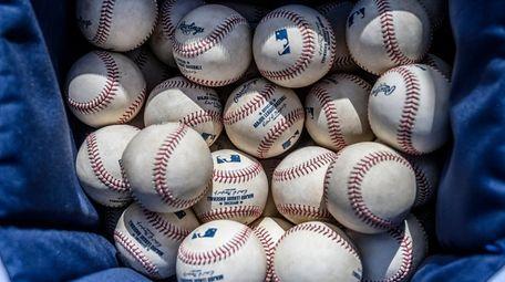 Baseballs await the beginning of a spring training