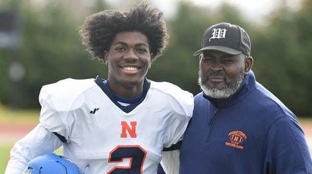 Idris Carter, left, and his father, Tony Carter,