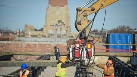 Crews from Corbex Construction work at Jones Beach