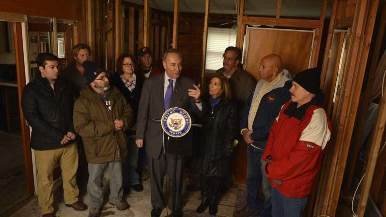 Sen. Charles Schumer (D-N.Y.), at the podium with
