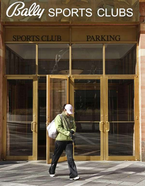 A woman is seen leaving a Bally Sports