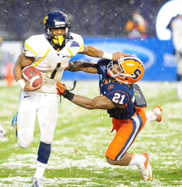 Tavon Austin of West Virginia escapes the tackle