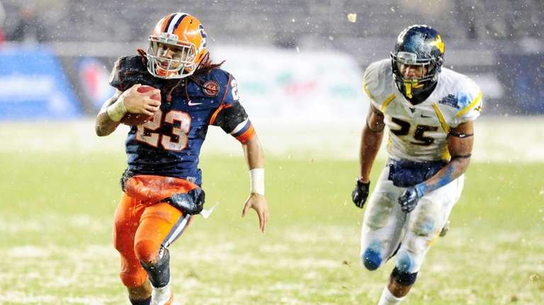 Prince-Tyson Gulley of Syracuse is chased by Darwin