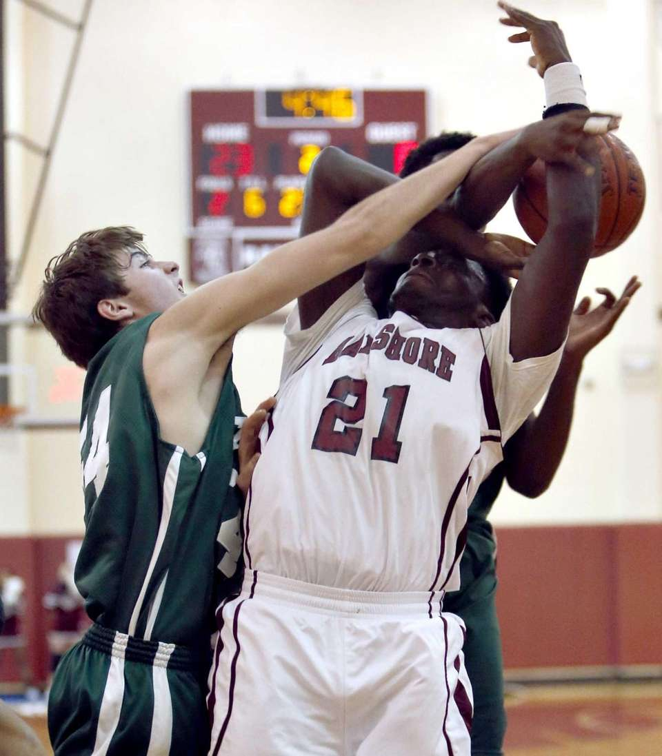 Bay Shore's Devin Farmer is fouled in the