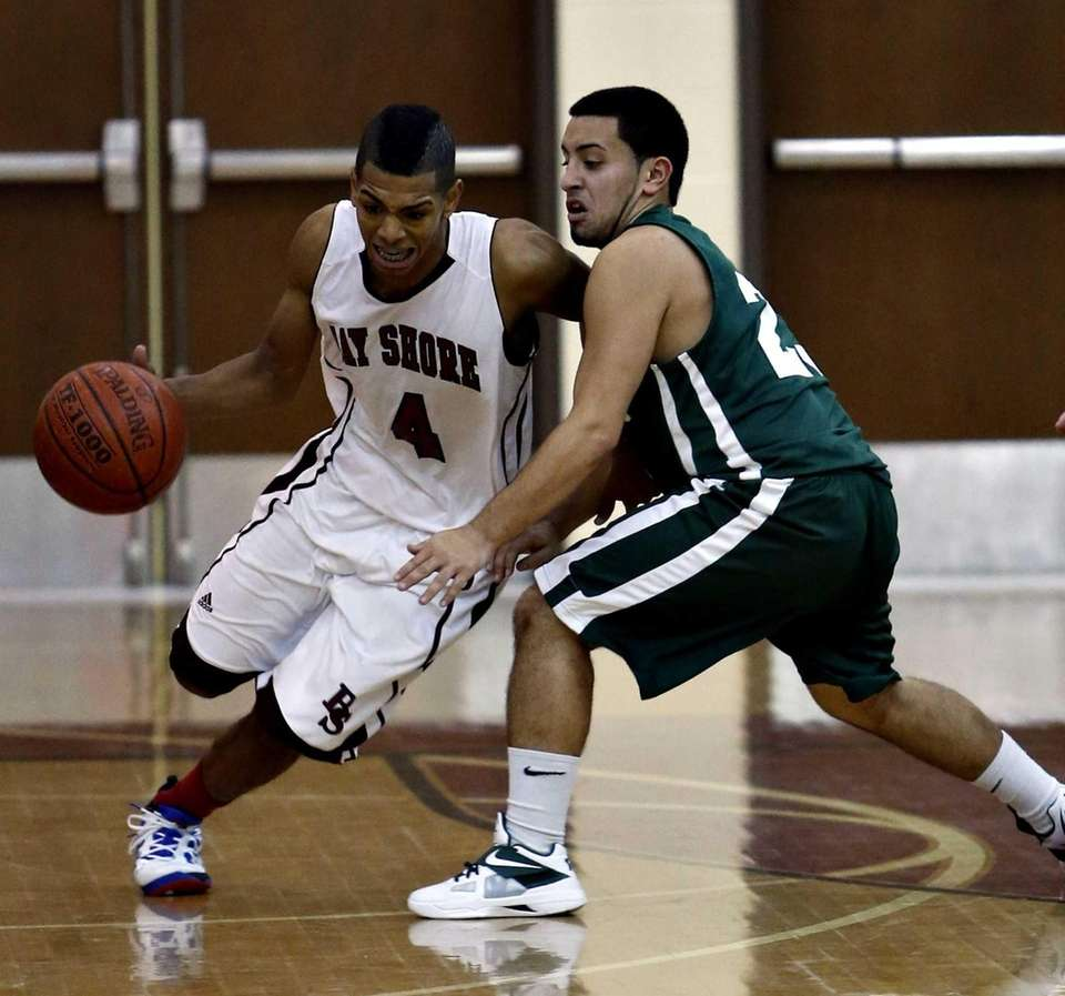 Bay Shore's Bryson Lassitere drives from the backcourt