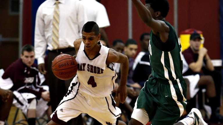 Bay Shore's Bryson Lassitere drives upcourt on a