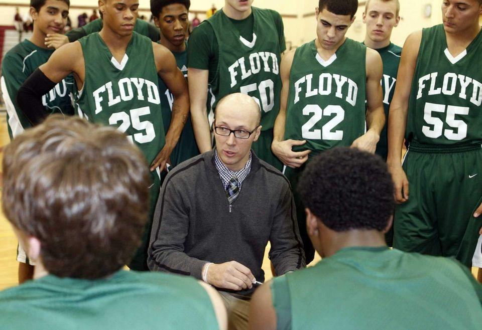 Floyd head coach Bob Hodgson speaks to his