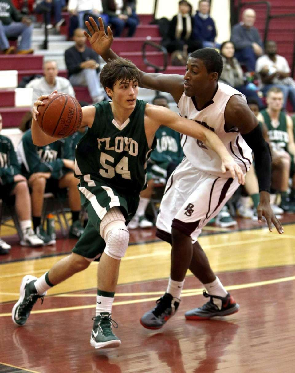 Floyd's Brian Samuelson drives the baseline against Bay