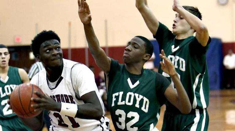 Bay Shore's Devin Farmer drives into the paint
