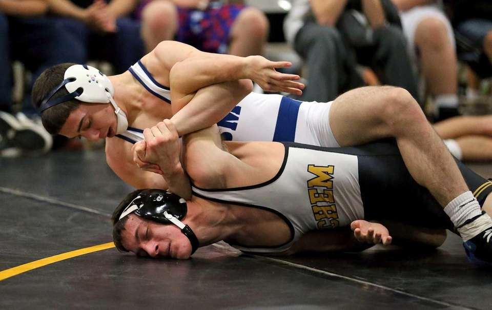 Eastport-South Manor's Travis Passaro, top, goes for the