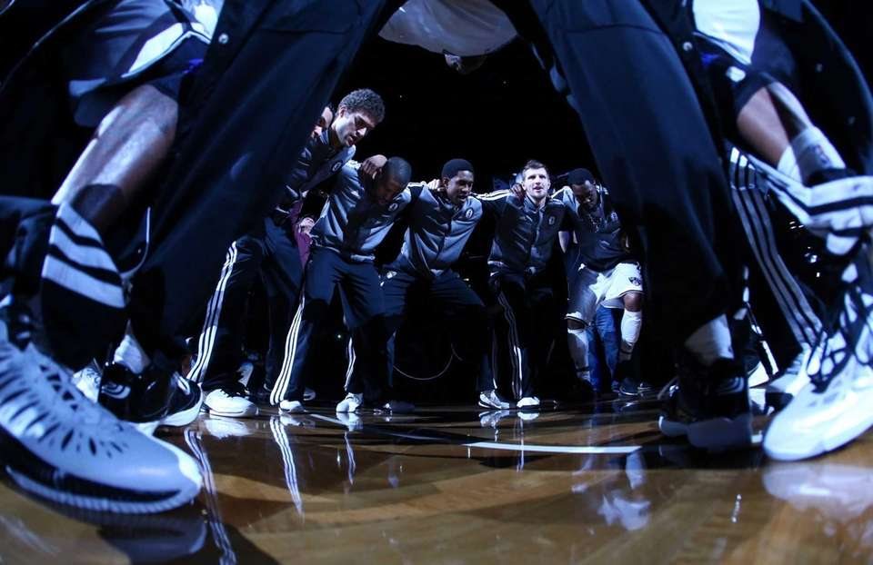 The Brooklyn Nets huddle before a game against