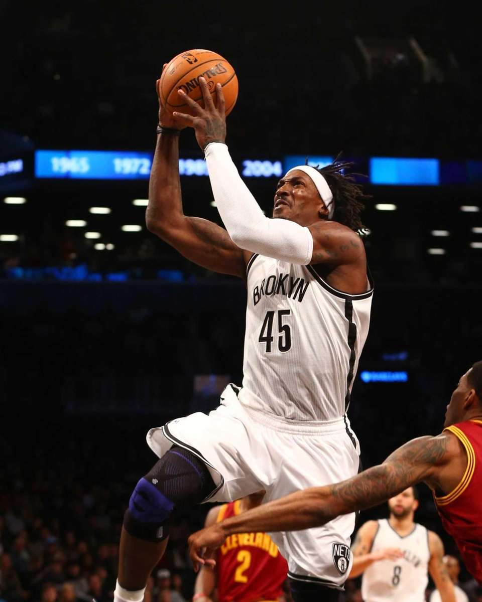 Gerald Wallace of the Brooklyn Nets goes to