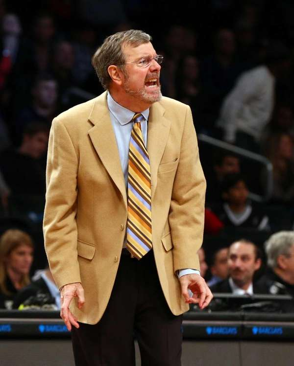 P.J. Carlesimo of the Nets looks on as