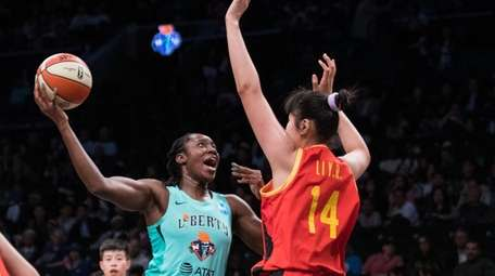 China National Team center Li Yueru (14) defends