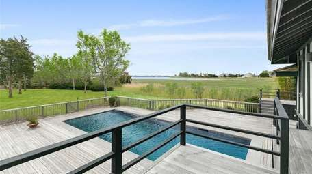 The property features a heated pool, expansive mahogany