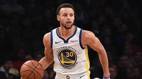 Golden State Warriors guard Stephen Curry dribbles the