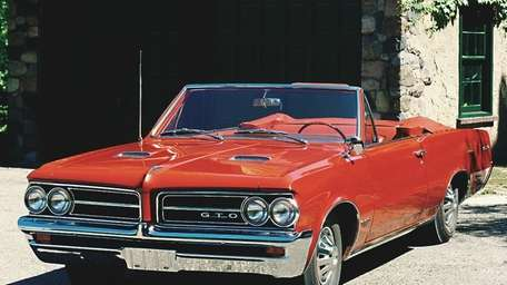 Mid-1960s Pontiac GTOs are quintessential muscle cars.