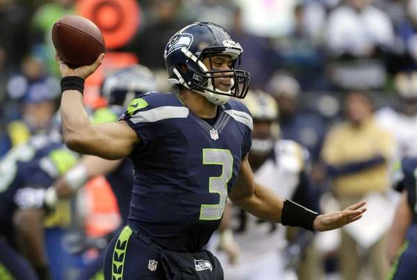 Seattle Seahawks quarterback Russell Wilson passes in the