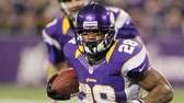 Adrian Peterson of the Minnesota Vikings runs against