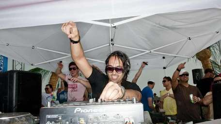 DJ Theo (pictured here at the now-defunct Neptune