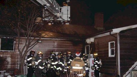 Firefighters battle a blaze in the former Bald