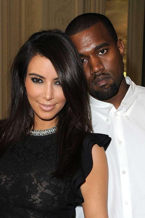 Kim Kardashian and Kanye West attend the Valentino