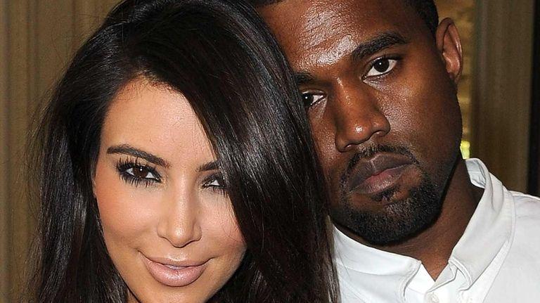 Kim Kardashian and Kanye West attend the Valentino