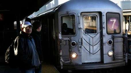 A 7 train enters a subway station in