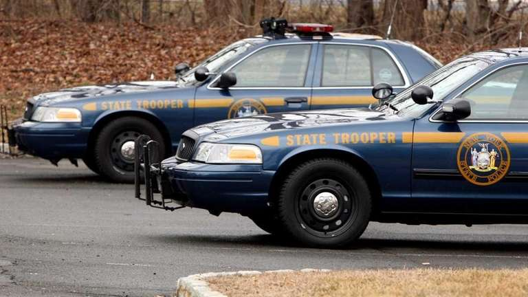 Trooper cars are pictured at the State Police