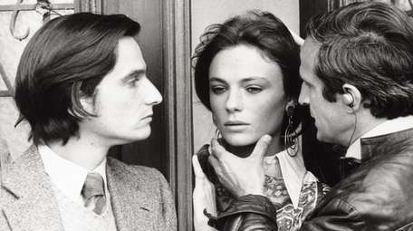 Francois Truffaut touches the face of