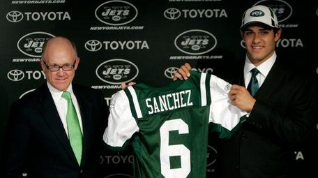 Jets owner Woddy Johnson, left, presents Mark Sanchez