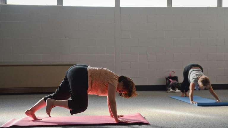 Sylvia Braun, of North Merrick, practices pilates during