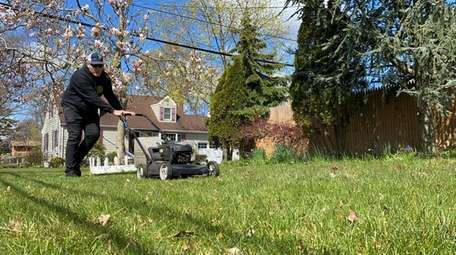 Michael Lindner, 17, has been cutting grass for