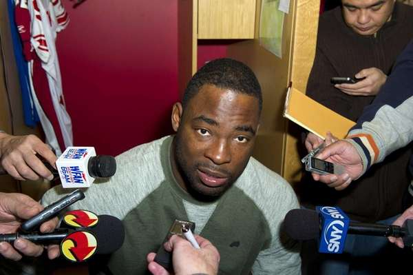 Justin Tuck addresses the media after cleaning out
