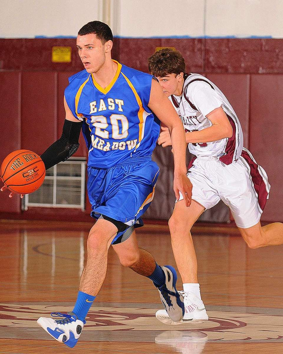 East Meadow center Joe Campay dribbles past midcourt
