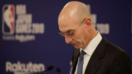 NBA Commissioner Adam Silver pauses while speaking at