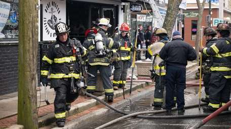 Firefighters extinguished a fire at a restaurant at