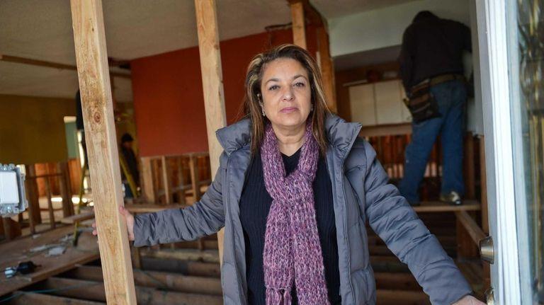 Aileen Arroyo at the front door of her