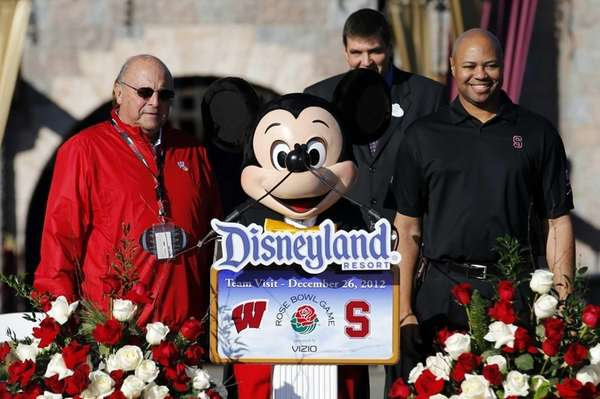 Wisconsin athletic director Barry Alvarez, left, a person