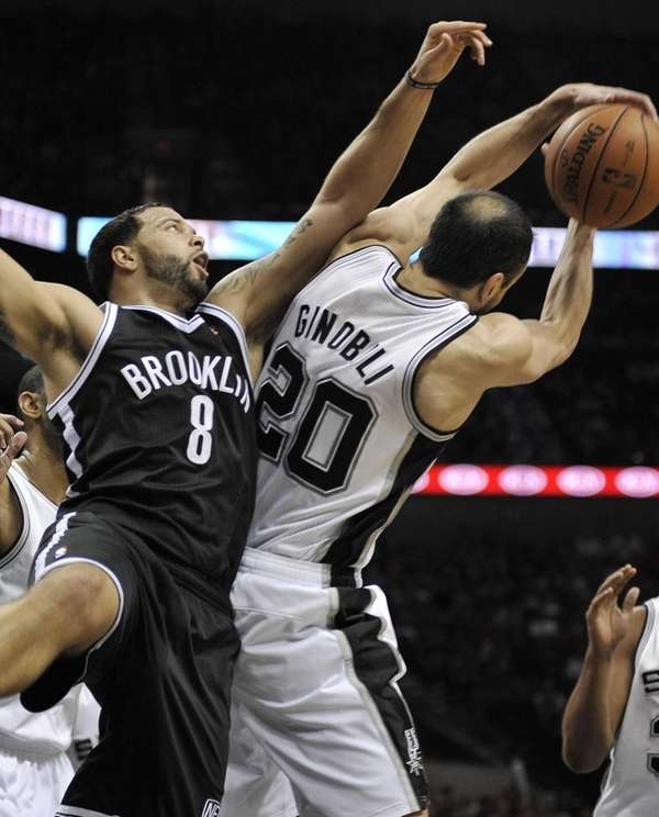 Deron Williams defends San Antonio Spurs' Manu Ginobili.