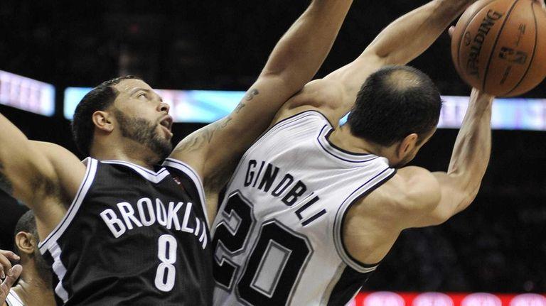 Deron Williams defends San Antonio Spurs' Manu Ginobili.