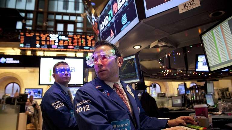New York Stock Exchange workers wear party glasses