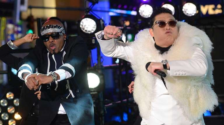 South Korean singer Psy performs with rapper MC