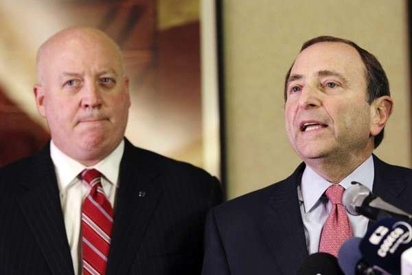 NHL Commissioner Gary Bettman, right, and deputy commissioner