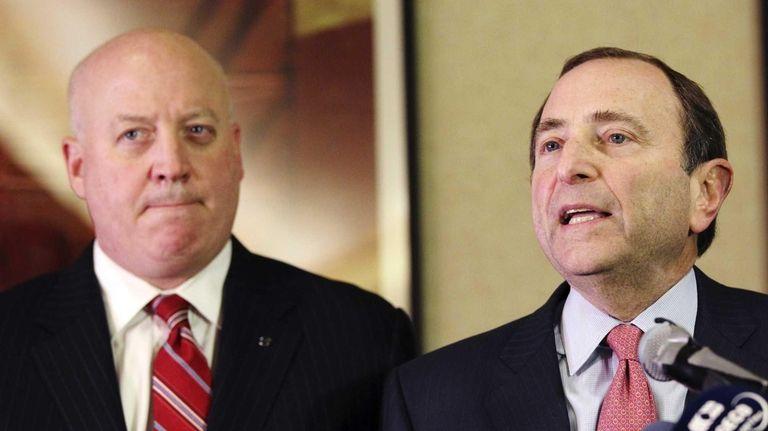NHL Commissioner Gary Bettman, right, and deputy commissioner